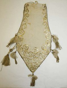 French reticule, c 1801, in silk with spangles. Very modern design, in a way. Spangles are backstitched on. Tassels appear to have netted ball tops.