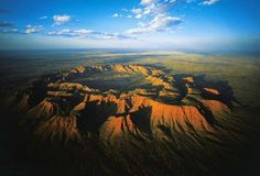 Gosses Bluff Meteoric crater, west of Mac Donnell Range, NT, Australia / by Yann Arthus-Bertrand Meteor Crater, Meteor Impact, Indigenous Knowledge, Arthus Bertrand, Ayers Rock, Namibia, World Heritage Sites, Heritage Month, Paisajes