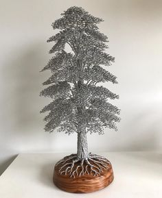CM212 is mounted on a Xylia wood base. Standing 380mm tall the sculpture represents a Western Red Cedar 'Zebrina'. #wiretreesinspire #wire #tree #sculpture #unique #handmade #art #craft #wood #gift #woodland #forest #nature #artmagazine #wireart #wireartist #bonsai #sculptor #original #natural #bonsaitree #wiretrees #wiretreesculpture #gallery #handmadeinbritain #forests #woodlands #handmadeatkew #handmadeuk #handmadehq www.wirewood.co.uk