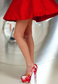 Her legs are tiny compared to the skirt! But I love the shoes!