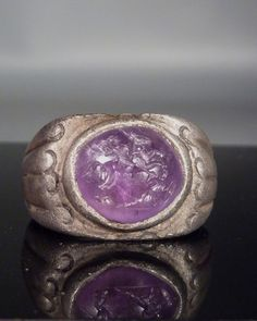 Roman silver ring with amethyst intaglio.      1st-2nd century AD  how do they find small items like this.