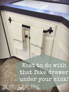 What to do with that fake drawer under your kitchen sink. Kitchen cabinet towel bar and other kitchen hacks at the Domestic Heart blog. (Diy Kitchen Hacks)