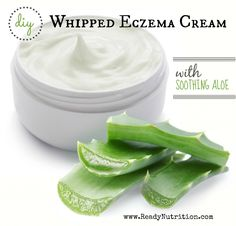 Opened plastic container with cream and aloe on a white background.