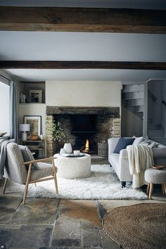 Interiors: Winter is coming... | Daily Mail Online Stairs In Living Room, Living Room White, Striped Walls, White Walls, Colours That Go With Grey, Flokati Rug, Blue Velvet Sofa, Cozy Cottage, Cottage Style