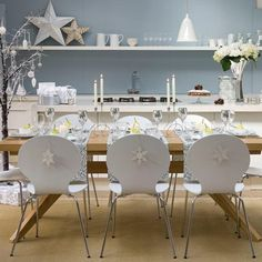 Simple yet elegant Christmas decor. Give your home a white theme this Christmas and opt for a slim twig tree to hang your Christmas adornments in. the white candles and flowers also compliment the decor beautifully.