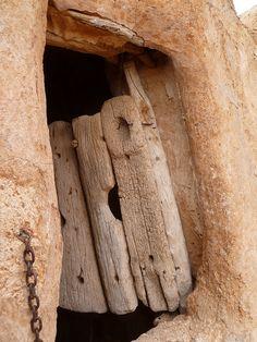 Ancient palm-trunk door.