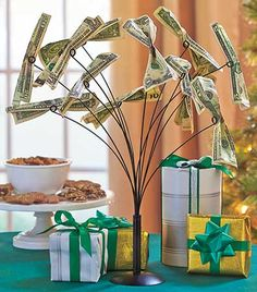 "The Money Tree is an innovative way to give or collect gifts. 12 Bendable branches have coiled tips that hold bills and gift cards. Fill it up for a creative display at home, or put it on a gift table party. 10-1/2"" dia. x 15-1/4""H. Metal.Go beyond the t"