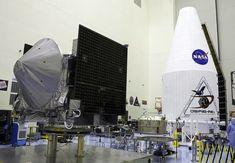 OSIRIS-REx Awaiting Encapsulation   >>>   NASA's asteroid-sampling OSIRIS-REx spacecraft being prepared for encapsulation in its payload fairing inside the Payload Hazardous Servicing Facility at NASA's Kennedy Space Center in Florida.