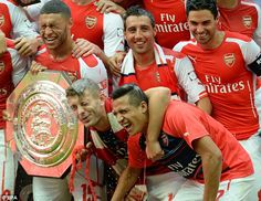 Shut your eyes: Oxlade-Chamberland, Wilshere, Cazorla, Sanchez and Arteta smile after getting wet