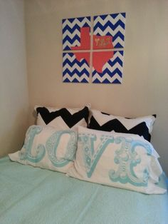 "Chevron bedroom - DIY chevron with state painting using four square canvases and glued initials cut out from glitter scrapbook paper; add chevron euro pillow covers and ""LO"" ""VE"" pillowcases"