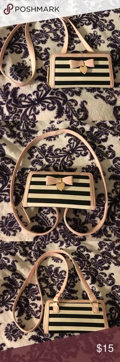 Betsey purse Black and white striped with baby pink trim The purse is perfect size for concerts or special events  Worn once  The inside is in mint condition with space for cards cash ID etc. Betsey Johnson Bags Crossbody Bags