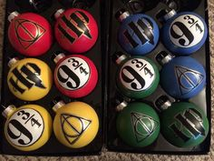 Set of 3 Hogwarts house-colored ornaments, $35