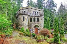houses that look like castles for sale | Pacific Northwest Castle in the Woods for Sale