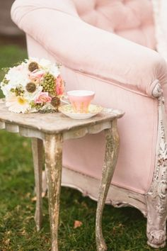 Pink tea cup and pink velvet settee. ROSA CLARO...