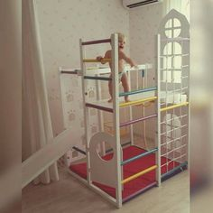 Idea for a kids` room. Wooden play house with a door and windows + second floor. Can be just an indoor playground or a place for sports and health. There are monkey bars and climbing wall too.