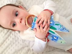 Are you in search of an unique and original gift for a baby or a kid? You've come to the right place! This gift set consisting of soft kitten toy with rattle, reversible bandana bib and bunny ear teether with wooden ring is perfect for your favorite little one's fashionable needs and playtime. All 100% cotton/terry cloth & eucalyptus tree ring. One size. Handmade in Vienna/Austria/EU, eco-certified & baby-friendly cotton.
