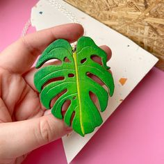 Whisk yourself away to a tropical island with this large monstera leaf necklace. This will make a great gift for any plant lover! A fun and quirky pendant that has been drawn by Colourful Cactus Flowers (us), then laser cut from birch plywood. Hand painted in lush green colours and with a gloss Green Colors, Colours, Laser Cut Jewelry, Leaf Necklace, Lush Green, Laser Cutting, Cactus, Great Gifts, Neon