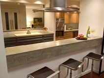 Trick your guests with this concrete drop nose bartop that appears to be floating / Concrete Countertops, Reaching Quiet. Charlotte, NC