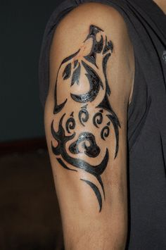 Black Tribal Wolf Tattoo Design On Right Sleeve - http://tattooideastrend.com/black-tribal-wolf-tattoo-design-on-right-sleeve/ - #Design, #Sleeve, #Tattoo