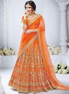 Feel like a diva in this auspicous orange silk lehenga richly embellished with resham, zari, kundan and stone work. It comes along with matching orange embellished blouse and net dupatta. The length of the lehenga is 44 inches. Lehenga Choli Designs, Ghagra Choli, Lehenga Anarkali, New Lehenga Choli, Orange Lehenga, Indian Lehenga, Indian Dresses, Indian Outfits, Indian Clothes