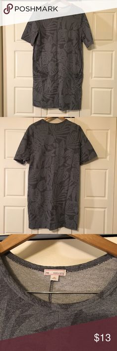 Floral print gray short sleeve dress Adorable gray tunic dress for spring. Darker gray floral pattern on light gray sweatshirt weight cotton. So soft. Good used condition. No rips stains or tears. GAP Dresses