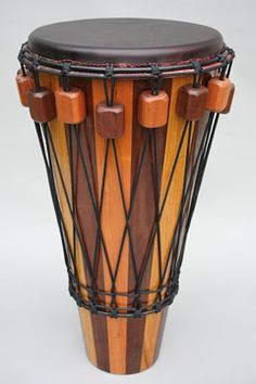Ashiko hand drum, from New World Drums... dyed head, blocks, diamond weave pattern... form plans to update my Ashkio...