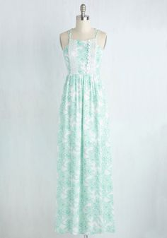 After being an ideal hostess to your tropically-located pals, they're eager to return the favor, and insist you bring this white sundress along! Pastel green flowers and a crocheted lace details mingle atop the breezy fabric of this open-back maxi, which provide a look fitting of the local flavor!