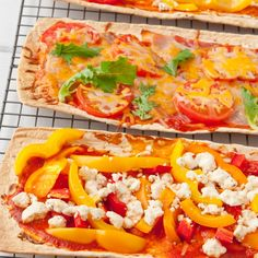 This flat bread pizza recipe is delicious.  First you bake the flatbreads, then add the toppings and heat up!. Flat Bread Pizzas Recipe from Grandmothers Kitchen.