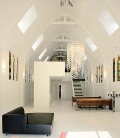 Chapel converted into a family home in the Netherlands, complete with original stained glass windows