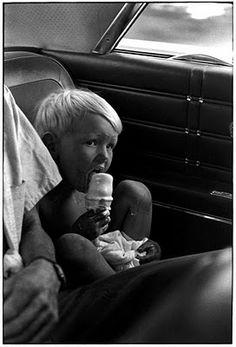 Young boy enjoying an ice cream cone.  William Gedney in Kentucky