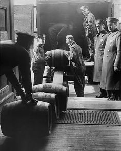 Barrels of alcohol confiscated in liquor raid during Prohibition.