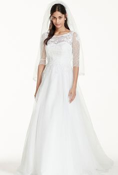 Brides: David's Bridal Collection. See More David's Bridal Collection GownsTulle ball gown with lace illusion bodice, elbow-length sleeves and lace appliqués.