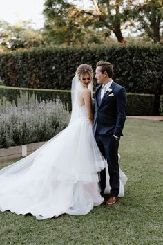 Hello gorgeous tulle ball gown wedding dress! The elegant long train and princess-like silhouette is perfect for the modern garden wedding. We love Luv Bridal! Classic Wedding Gowns, Gown Wedding, Wedding Dresses, Tulle Ball Gown, Ball Gowns, Hello Gorgeous, Designer Dresses, Bride, Princess