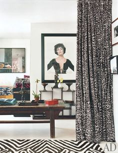 In the guest room is a Bert Stern photograph of Elizabeth Taylor; the carpet is a Von Furstenberg design for the Rug Company.