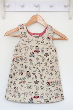 A personal favourite from my Etsy shop https://www.etsy.com/uk/listing/237774286/alice-in-wonderland-themed-pinafore