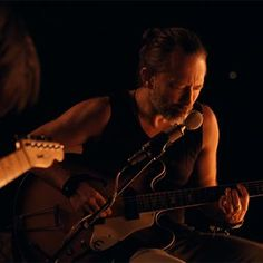 Music: Radiohead have a campfire jam sesh in 'Present Tense' video