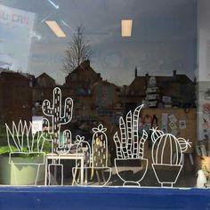 Cactus tekening op raam