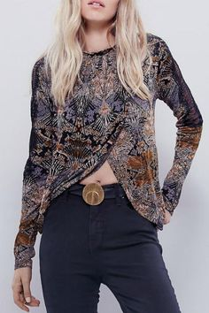 Printed mock neck top featuring a high low hem with a surplice front. Wide, oversized body with an open keyhole in back. Sheer lace along the shoulders with eyelash trim. Machine wash cold. Nouveau Top by Free People. Clothing - Tops - Long Sleeve New Hampshire