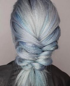 One way to elevate a typical braid is by adding a cool creased wave throughout your plait.