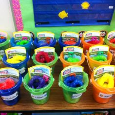 Bucket Filler themed - end of year gifts for students. Book, bookmark, lei, ice cream scented bubbles, candy...etc. --Zayda