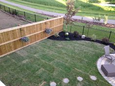 Garden project with charcoal mulched flower beds, fire pit and green space!