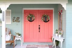 Cheery coral painted front doors Loving these bright front coral painted doors! So easy to make a statement with bold front door paint choices using DecoArt Inc.'s Curb Appeal paint. Coral Front Doors, Coral Door, Painted Front Doors, Front Door Colors, Front Door Decor, Front Porch, Exterior Front Doors, Exterior House Colors, Exterior Paint