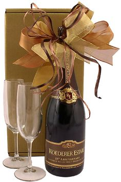 Tasteful and classic this champagne gift is the quintessential answer to many celebratory occasions paired with champagne flutes boxed and bowed in tones of gold. Alcohol Gift Baskets, Champagne Gift Baskets, Champagne Brunch, Alcohol Gifts, Wine Gift Baskets, Gifts For Wine Lovers, Wine Gifts, Roederer Champagne, Gift Wrapping Tutorial