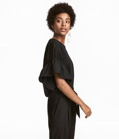 20 Budget-Friendly Black Ruffle Tops – Wear Black | Drink Champagne  H&M – T-shirt with Ruffled Sleeves – $17.99