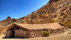 Luna's Jacal, BIg Bend NP. Gilberto Luna built this jacal about 1890. Its 4 foot walls are made of sandstone & limestone with forked poles set upright into the walls supporting the roof poles. The roof is made of ocotillo branches weighted down with earth & stones.  Luna raised a large family here and lived here until 1947 when he died at age 108.