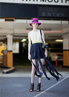 I love this Fashionista's skirt! Super innovative and a new take on the double-layer skirt. Also adore the shoes and the hat.