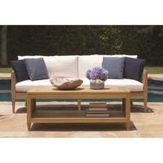 Entertain outside in comfort and style with the Marin Wood Outdoor Sofa. Designed by Michael Berman, it is constructed of solid teak and detailed with stainless steel accents.