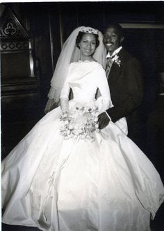 Old photo of African American couple's wedding picture. Love the neckline of her dress.