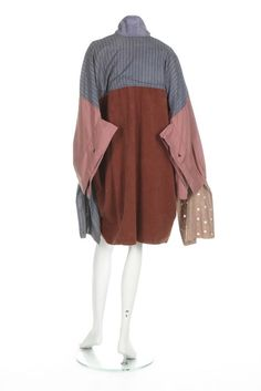 A John Galliano patchwork 'Big' shirt, 'The Ludic Game' collection,  Autumn-Winter, 1985-86, with John Galliano 1 label,  of giant proportions with elongated sleeves with buttoned back panels, mainly shades of mauve, brown and lavender, incorporating stripes, faux suede and broderie anglaise