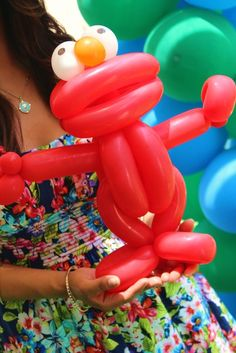 Learn to create balloon decorations, how to twist balloons and how to make balloon animals with our online courses and tutorials Clown Party, Elmo Party, Yellow Balloons, Bubble Balloons, Sesame Street Party, Sesame Street Birthday, Elmo Birthday, Birthday Parties, Easy Balloon Animals